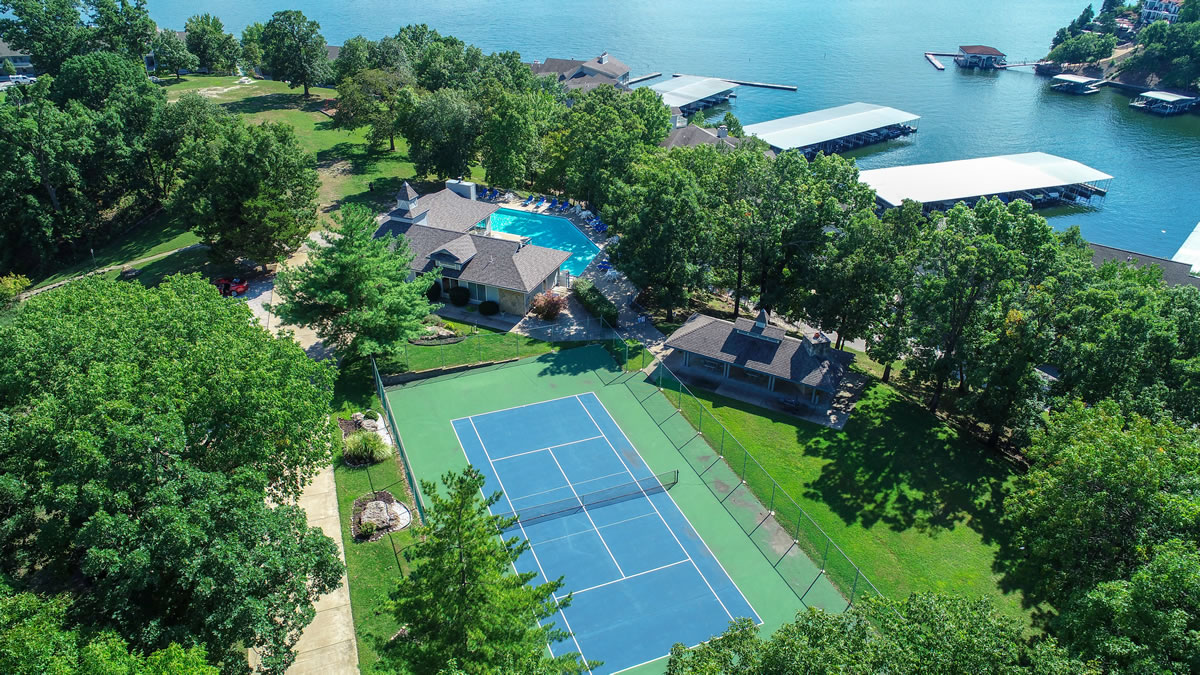 Lake Ozark, MO Condo Overview of Tennis Court and Pool